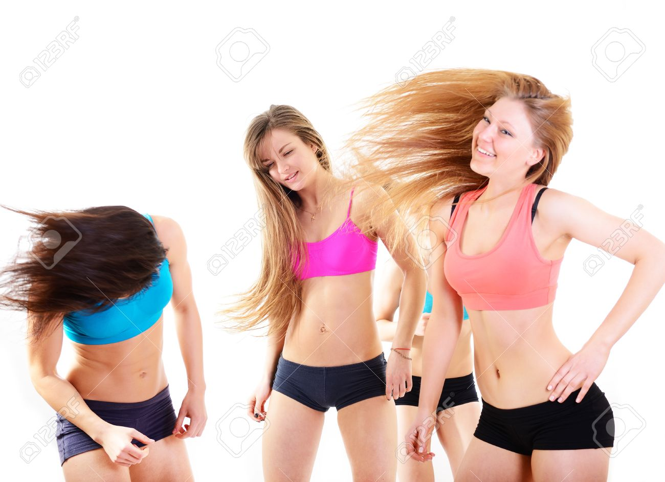 Group Of Happy Fitness Teen Girls Have Fun Dancing And Jumping Over White Background