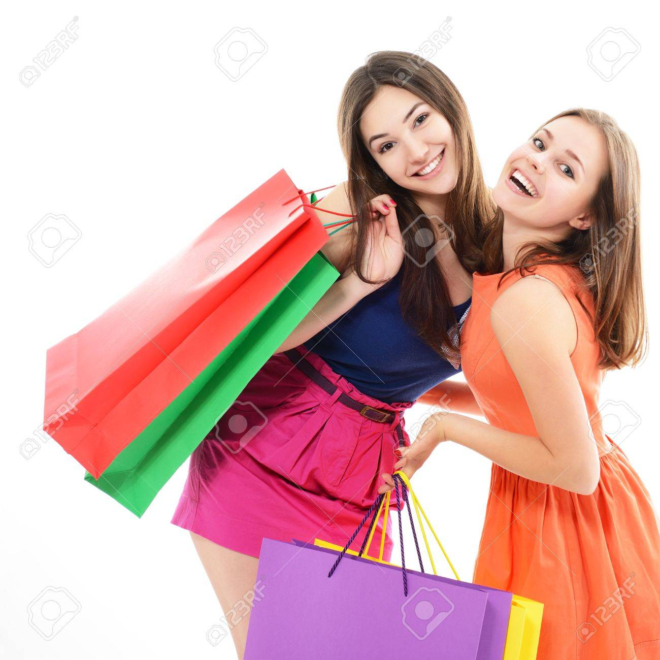 beautiful happy teen girls with colored shopping sale bags over white Stock Photo - 19758746