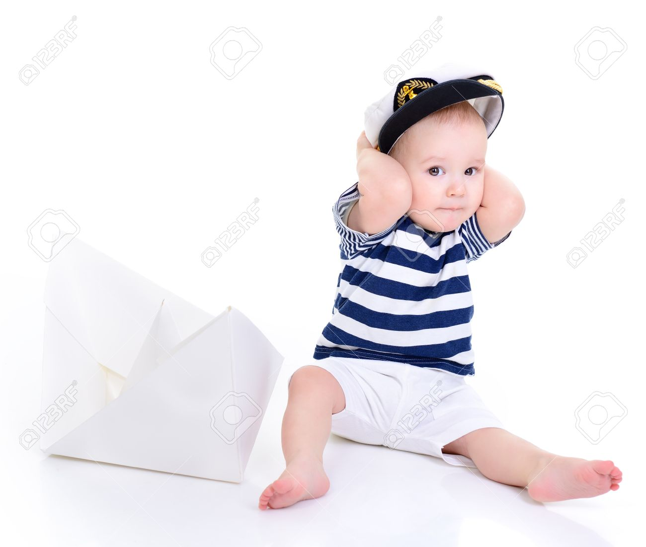 cute baby boy sitting in captain cap with ship of paper - sailor in future f3c4f1241ddb