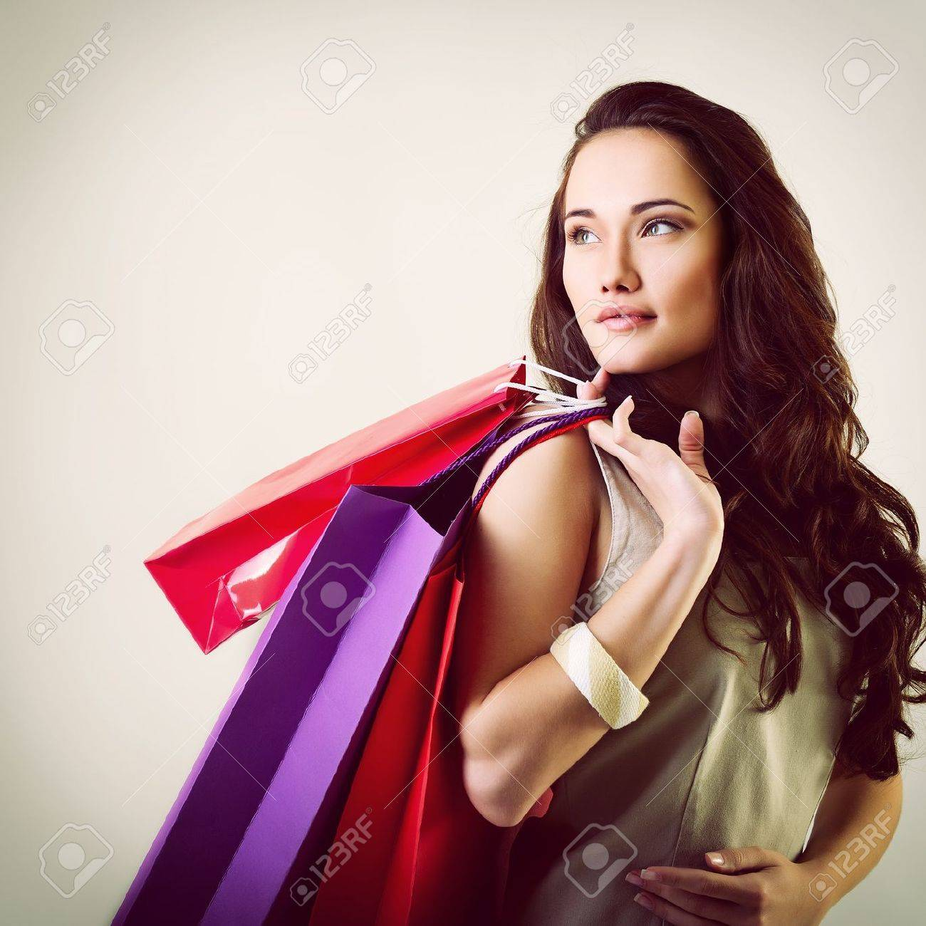 Beautiful Young Woman Holding Colored Shopping Bags, Toned Stock ...