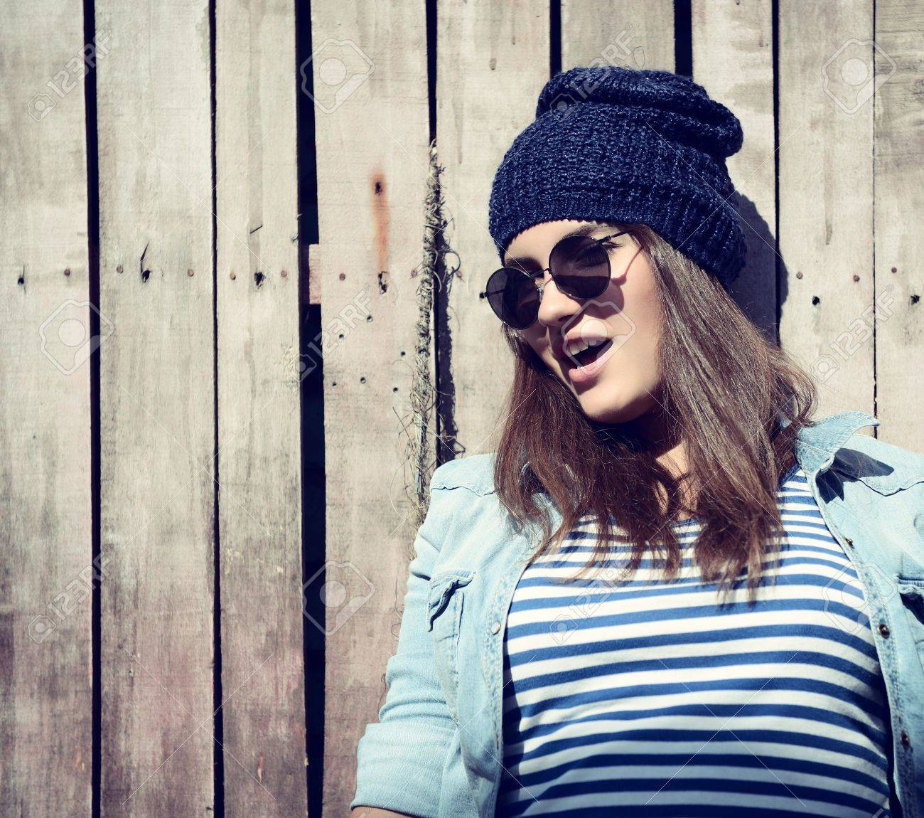 Beautiful Cool Girl In Hat And Sunglasses Against Grunge Wooden Stock Photo Picture And Royalty Free Image Image 22025069