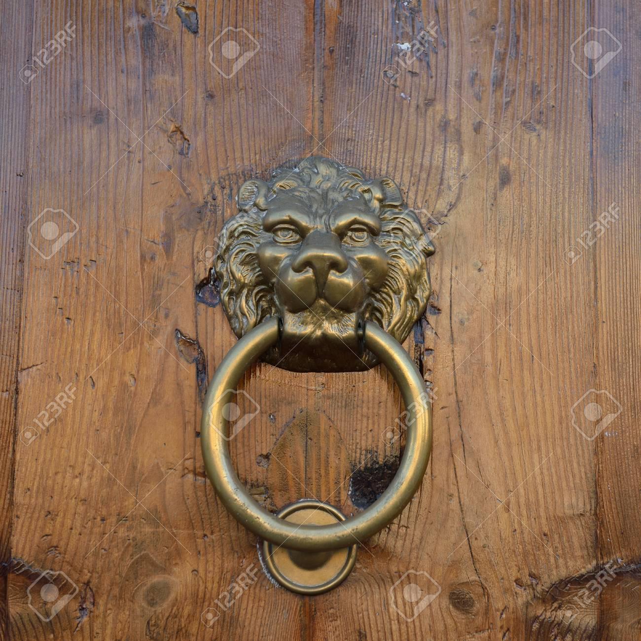 Antique Door Knob With Lionu0027s Head On Old Wooden Obsolete Door, Rome, Italy  Stock