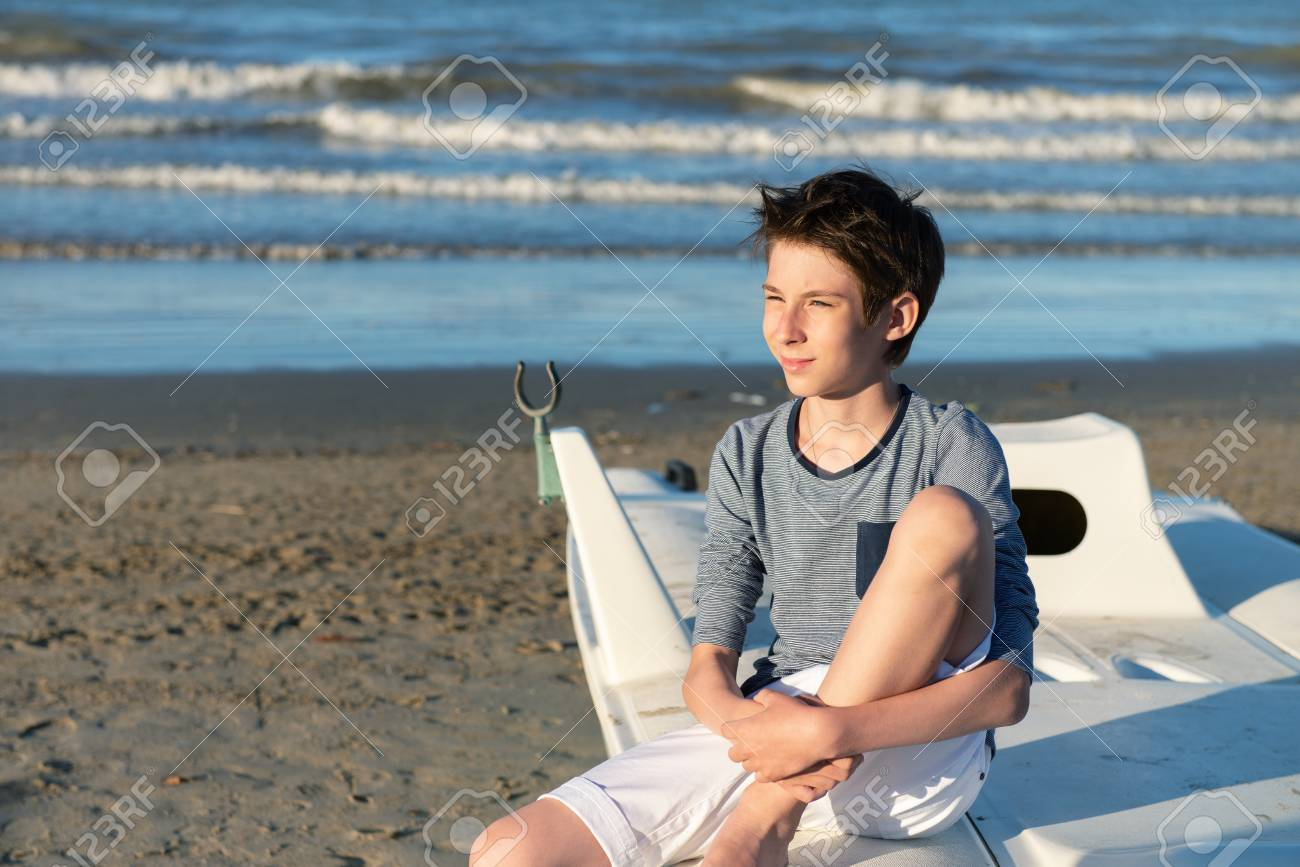 Young Boy Sitting On Catamaran At The Summer Beach Cute Smiling