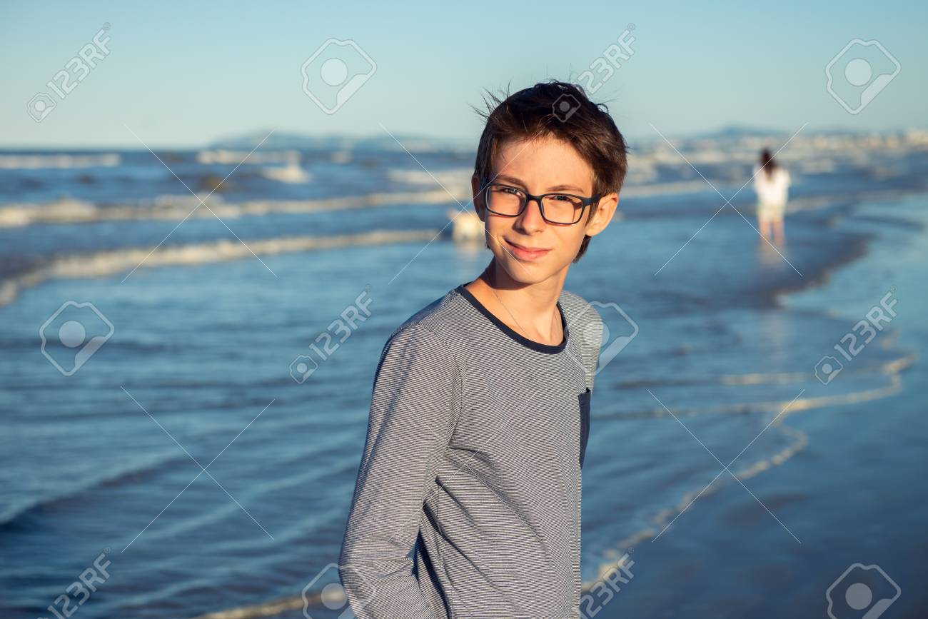 Young Boy Posing At The Summer Beach Cute Smiling Happy 12 Years