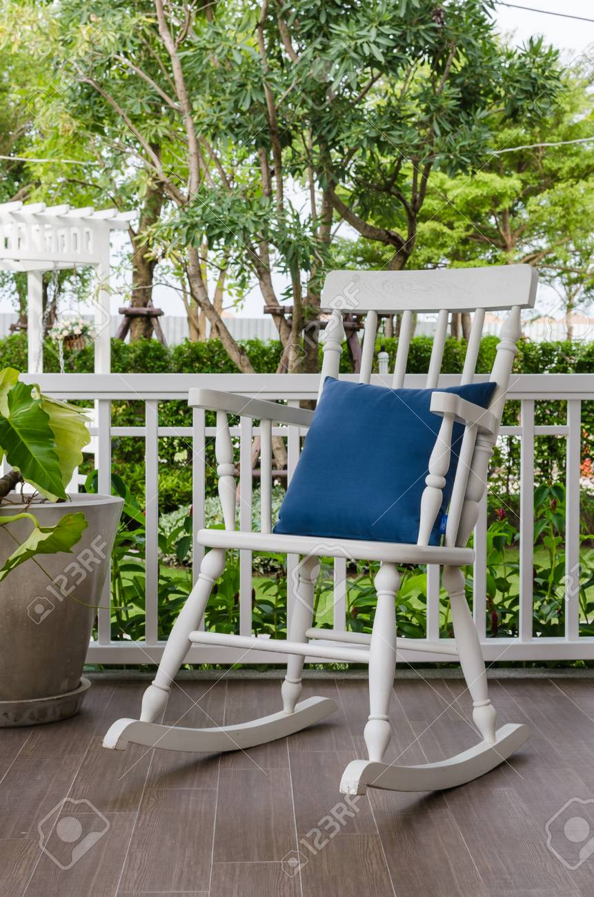 Stock Photo   White Wooden Rocking Chair On Front Porch At Home