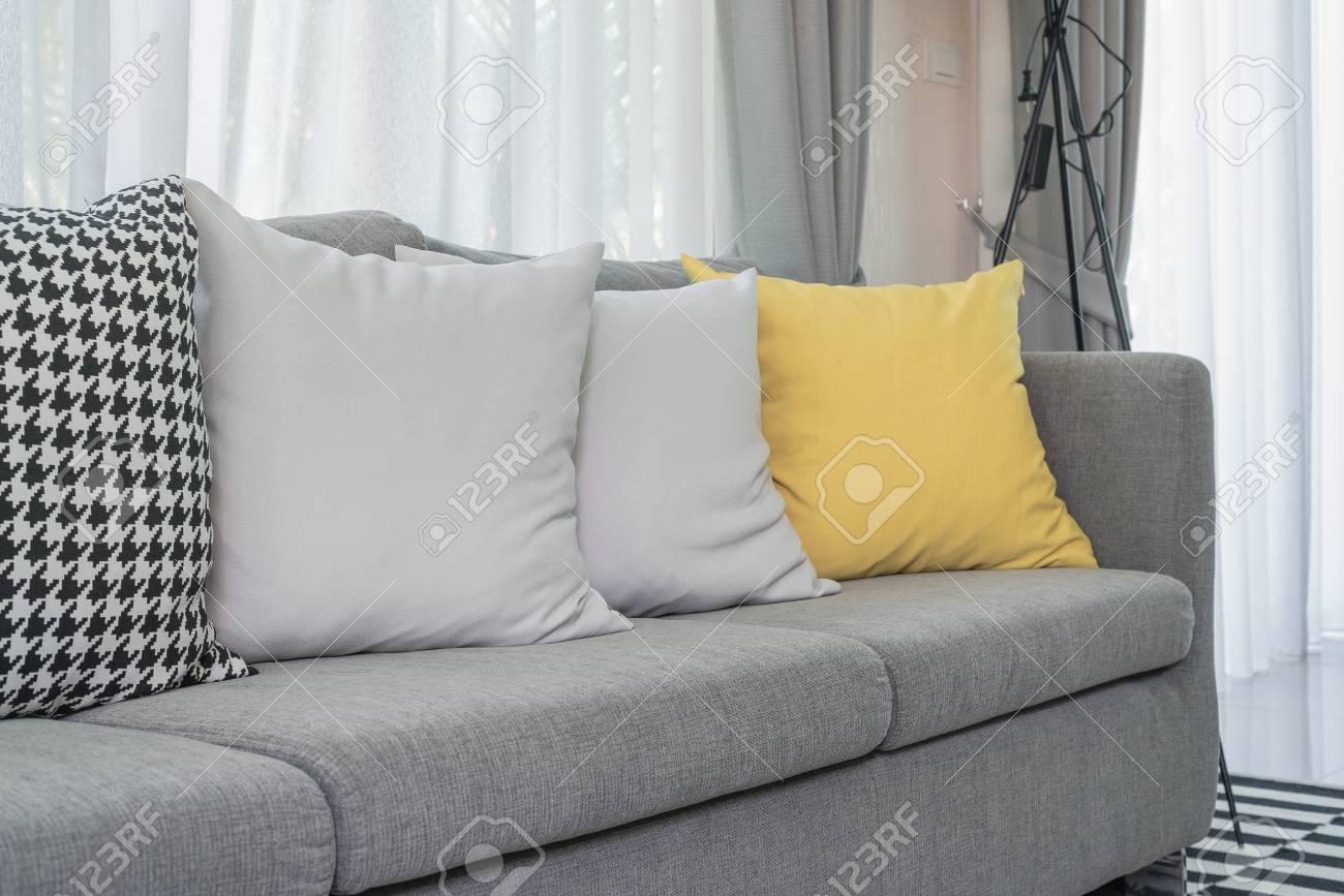 Cuscini Divano Grigio.Yellow And Grey Pillows On Modern Sofa In Living Room Stock Photo