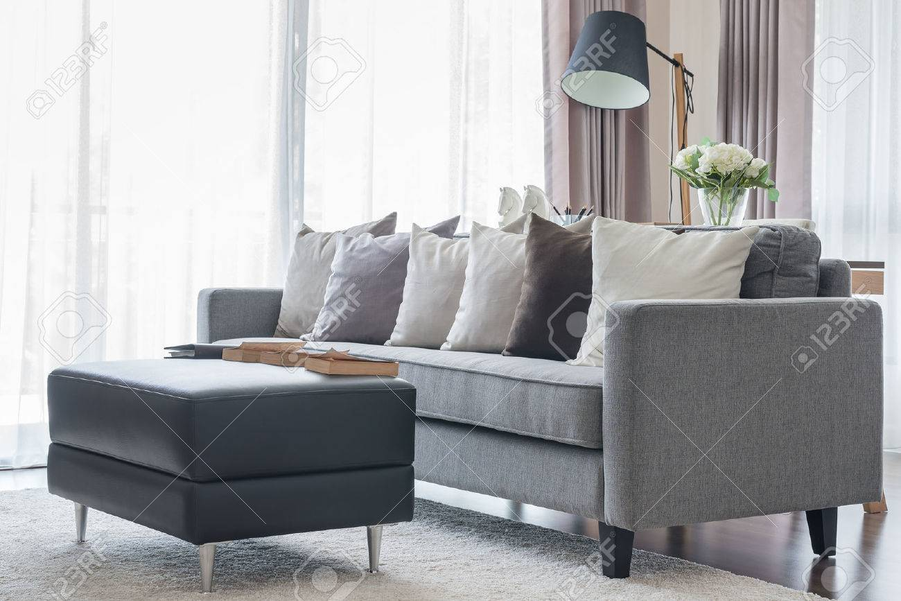 Modern Grey Sofa With Pillows And Black Table In Living Room.. Stock ...