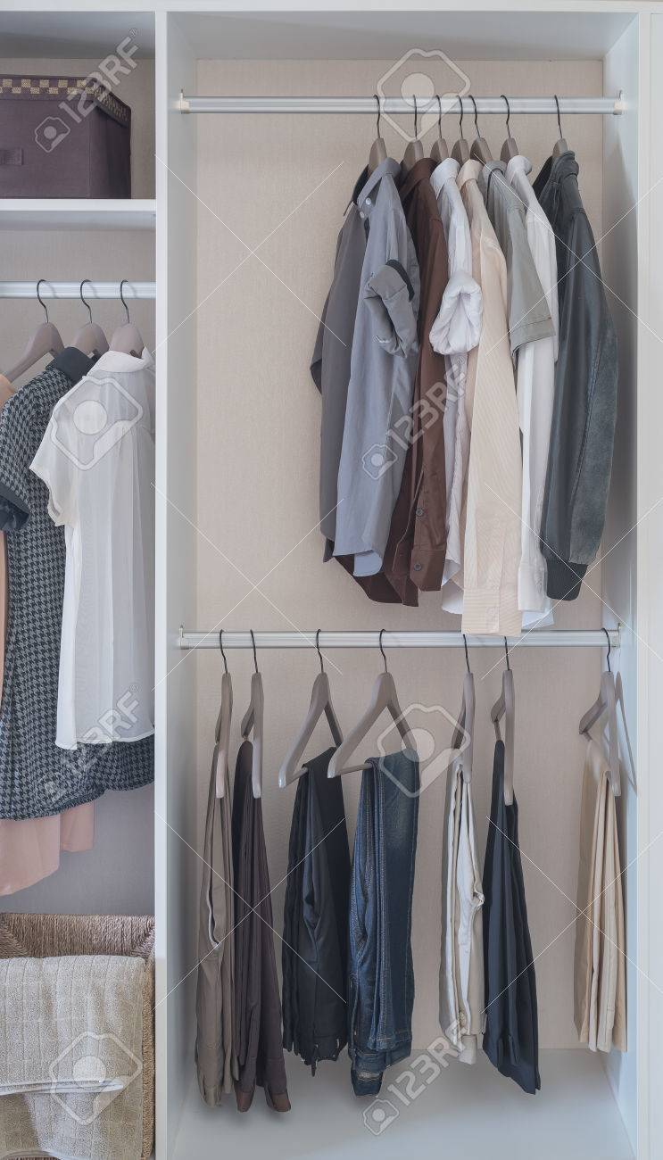 Clothes Hanging In White Wardrobe At Home Stock Photo Picture And