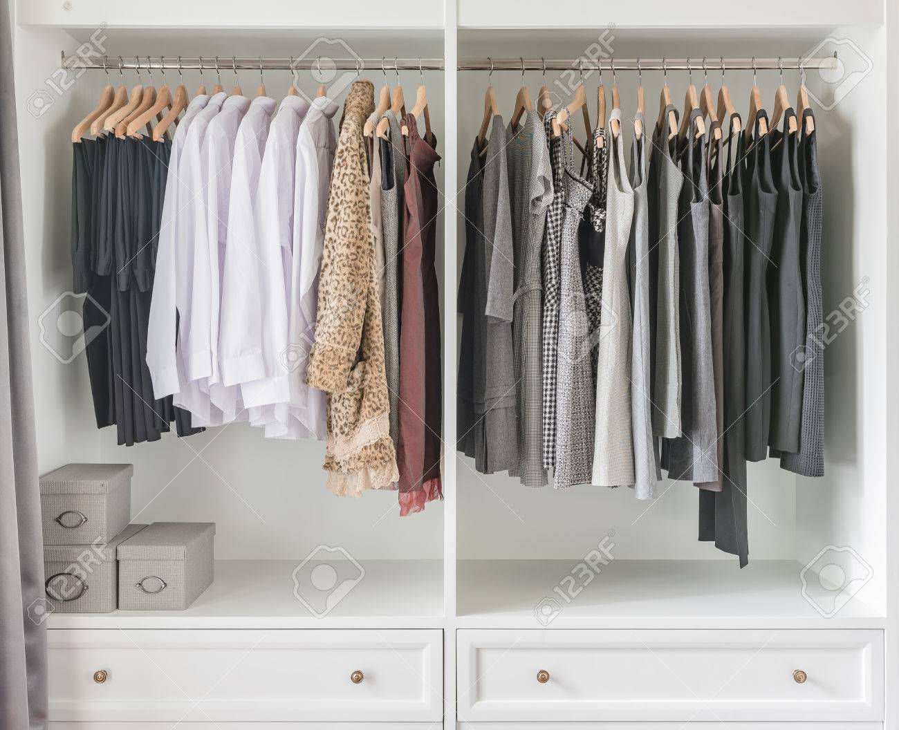 White Wardrobe With Clothes Hanging On Rail Stock Photo Picture