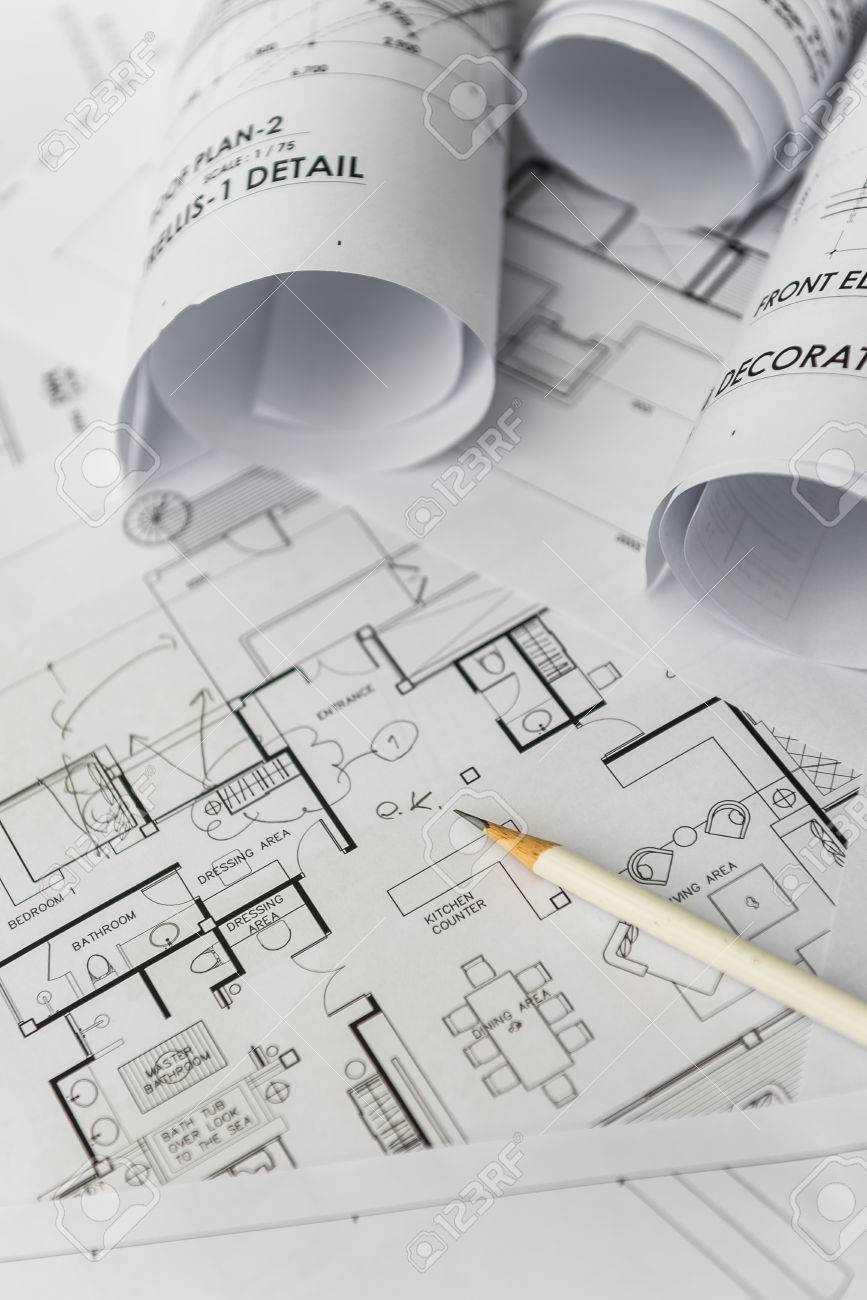 White pencil on architectural for construction drawings with stock stock photo white pencil on architectural for construction drawings with roll of blueprint malvernweather Choice Image