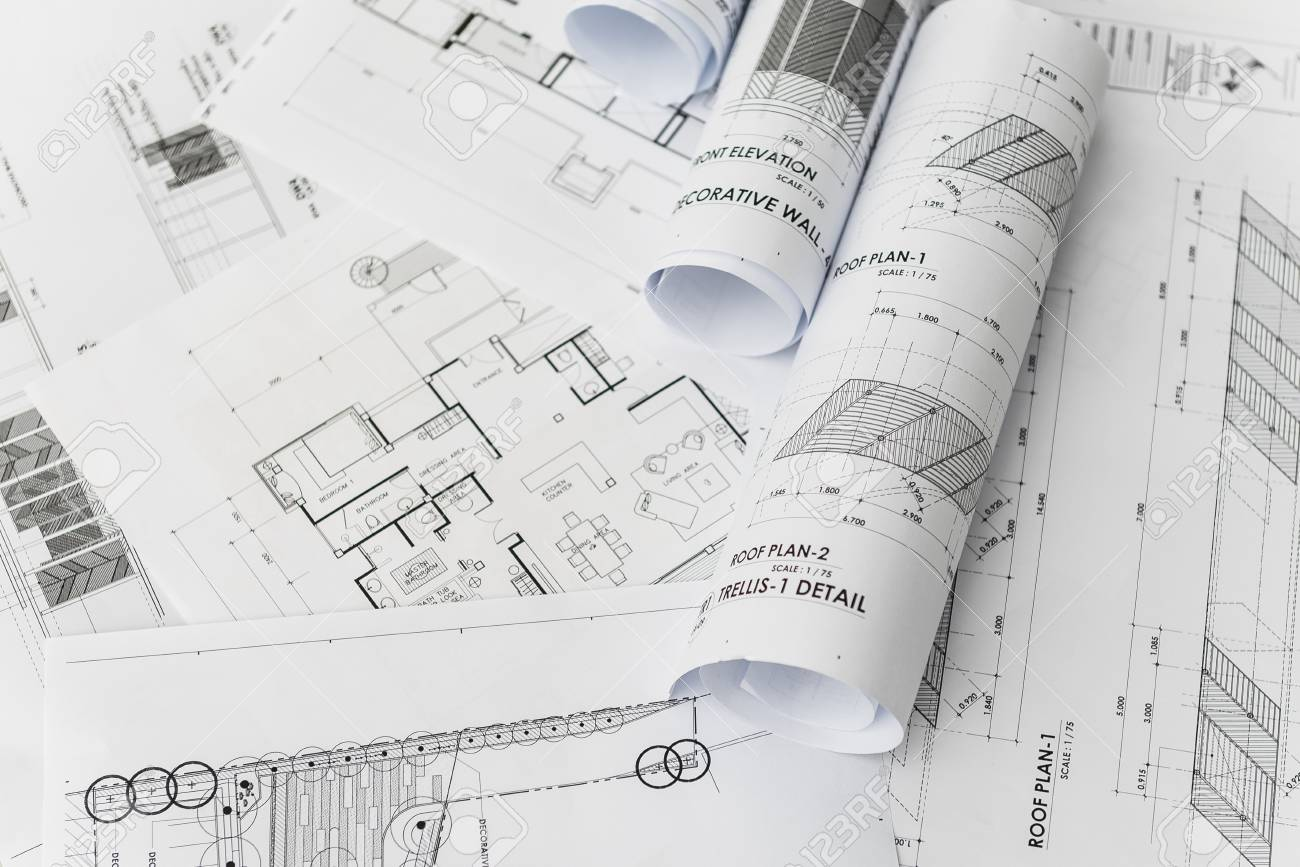 architectural for construction drawings with roll of blueprint