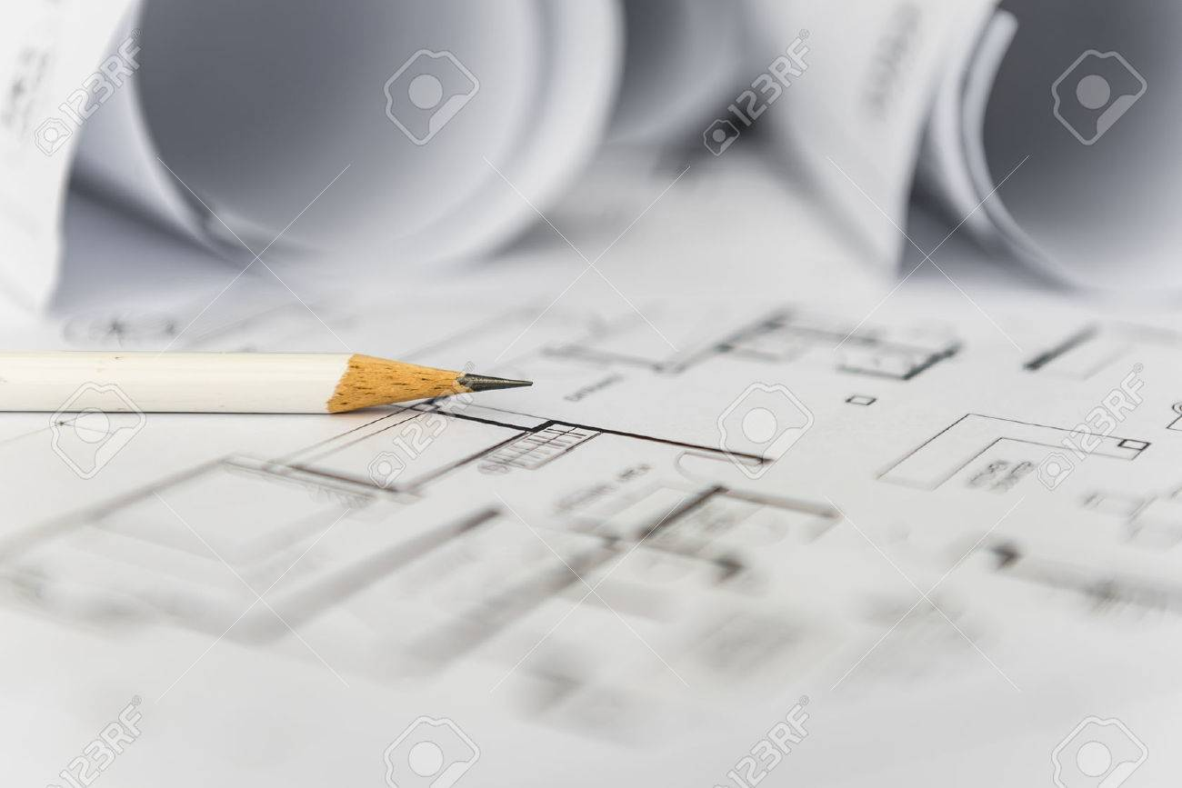 White pencil on architectural for construction drawings with stock white pencil on architectural for construction drawings with roll of blueprint stock photo 50288849 malvernweather Choice Image