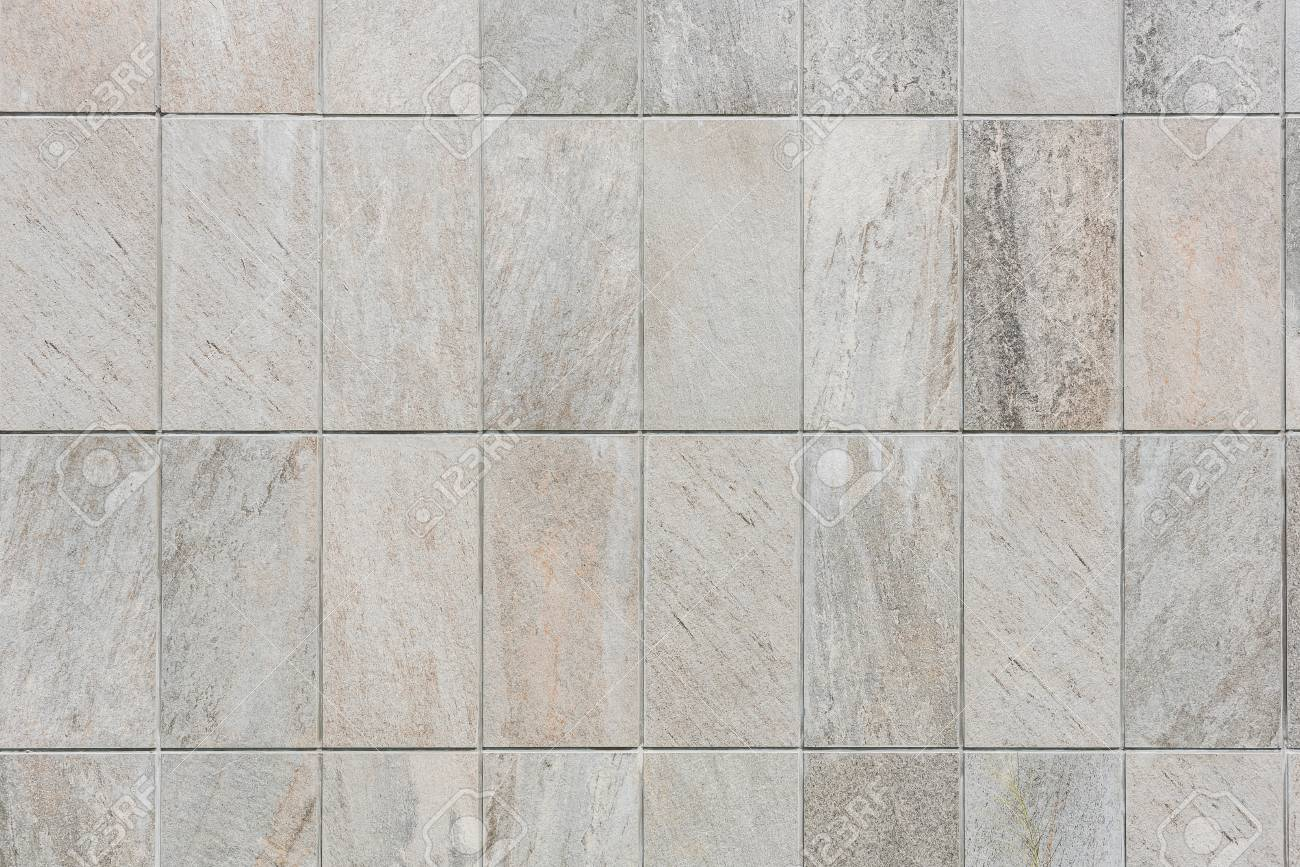 Natural sand stone tile wall seamless background and texture stock