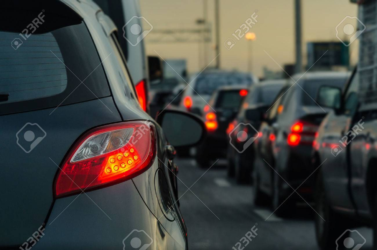 traffic jam with row of cars on expressway during rush hour - 54805714