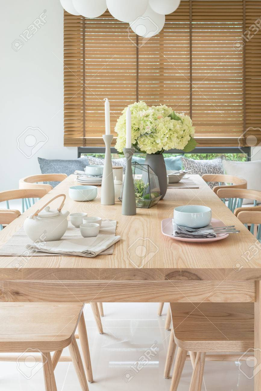 Picture of: Wooden Dining Table In Modern Dining Room With Table Set And Stock Photo Picture And Royalty Free Image Image 80198552