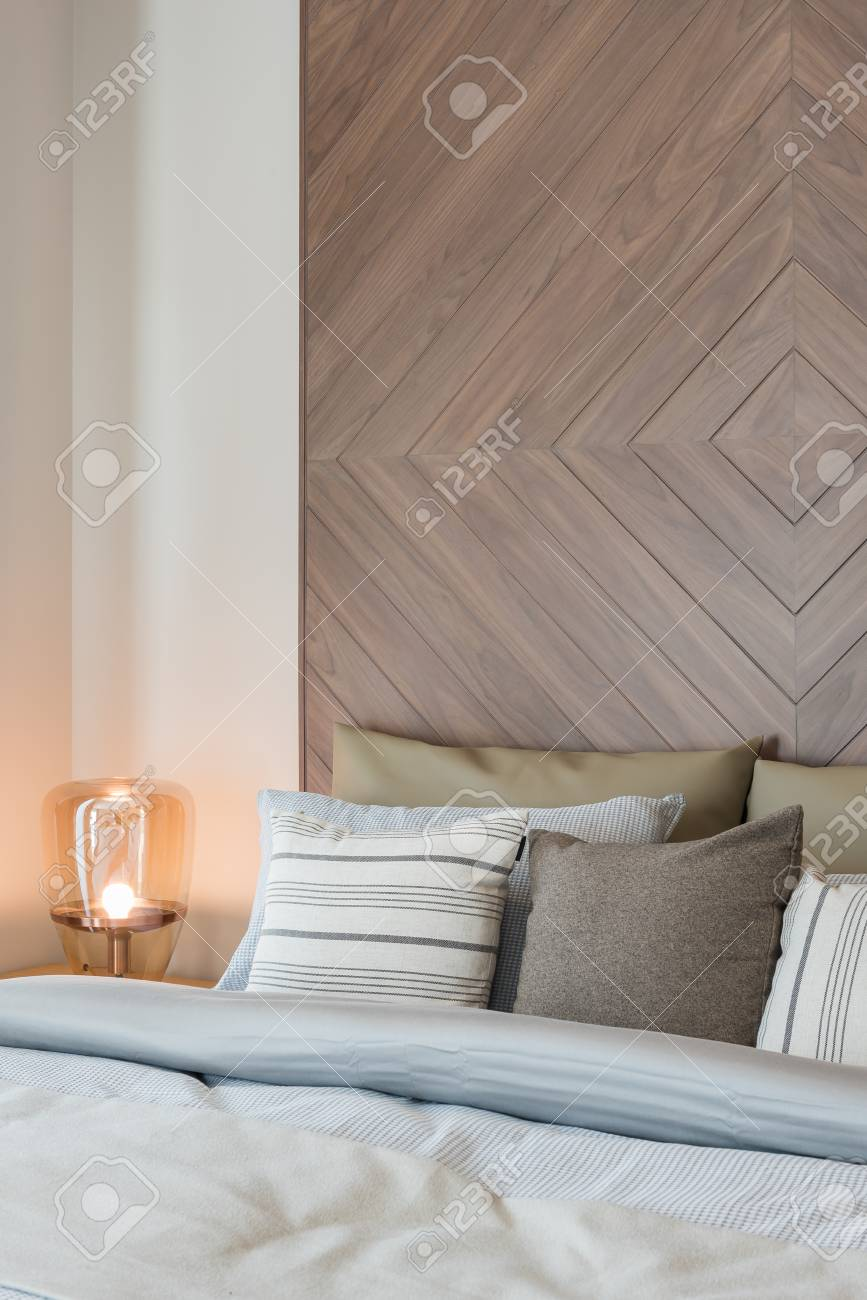 Set Of Pillows On Bed With Wooden Wall Decoration In Classic Stock Photo Picture And Royalty Free Image Image 96989676