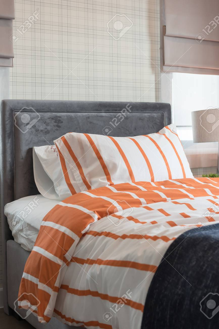 single bed in modern bedroom with orange and white color tone,..