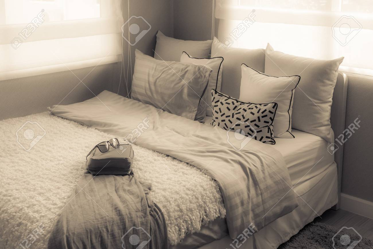 . modern single bed in modern bedroom with set of pillows  interior
