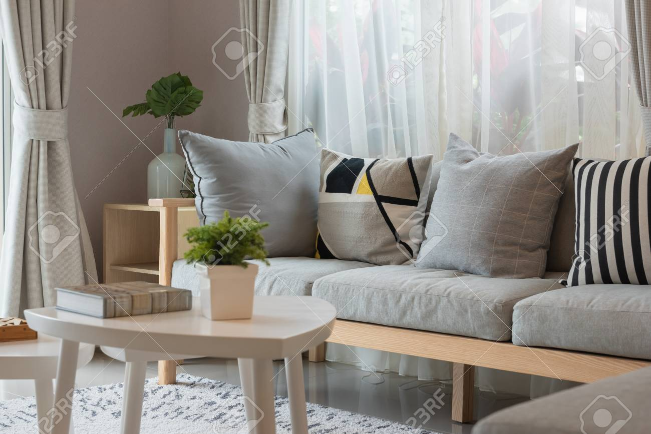 modern living room with wooden sofa and gray pillows, interior..