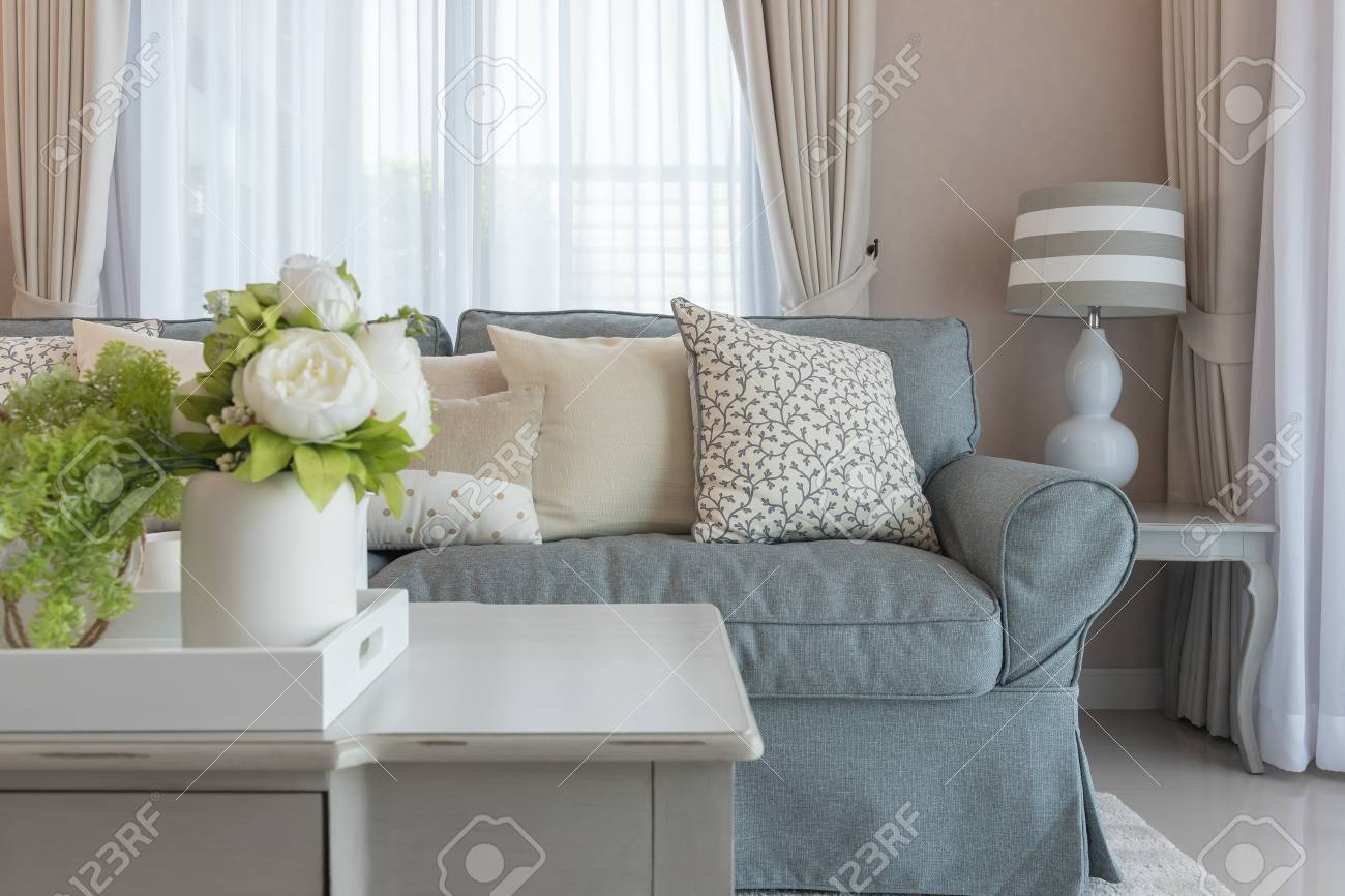 classic living room style with elegance sofa and set of pillows,..