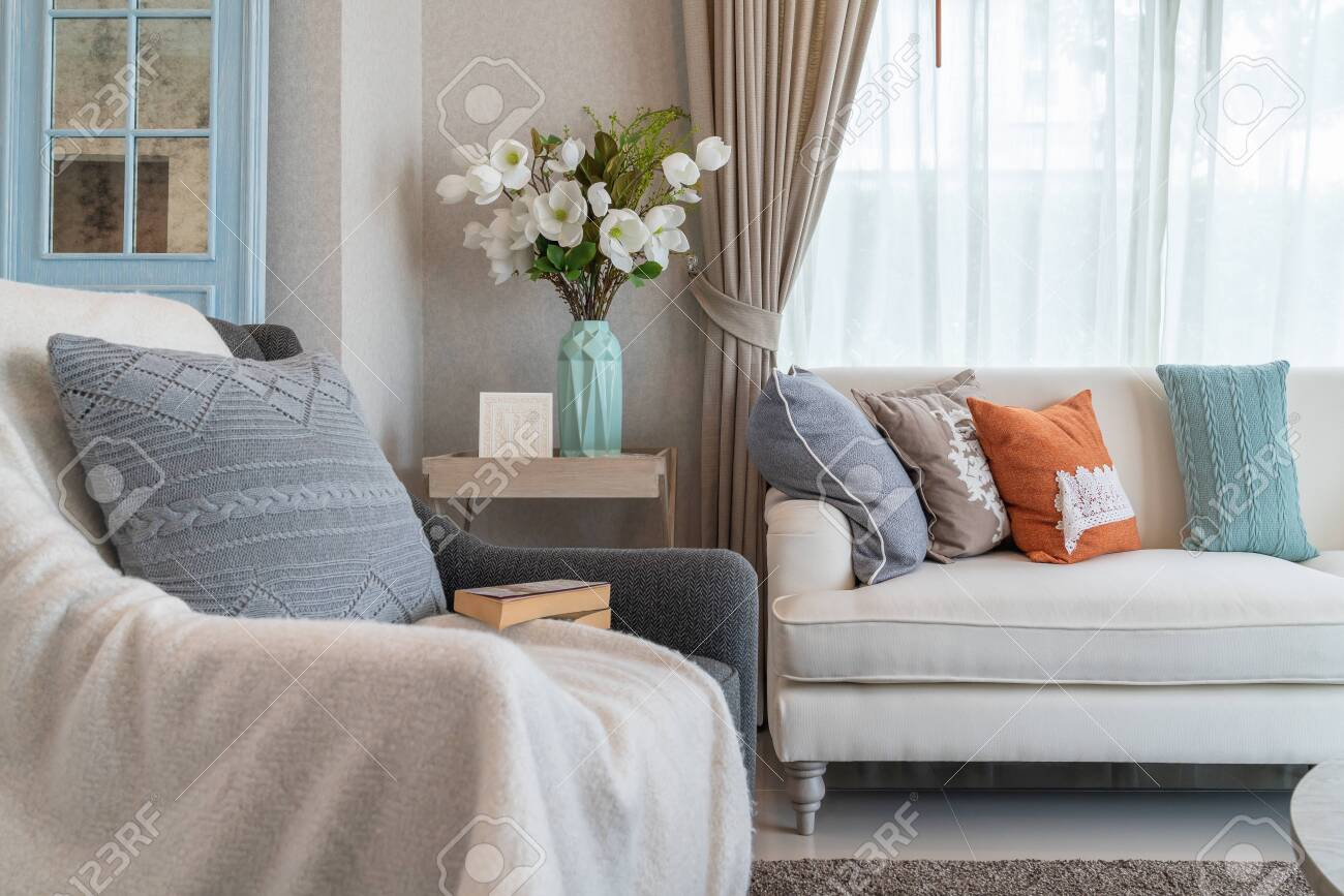 classic style living room with classic sofa and set of pillows,..