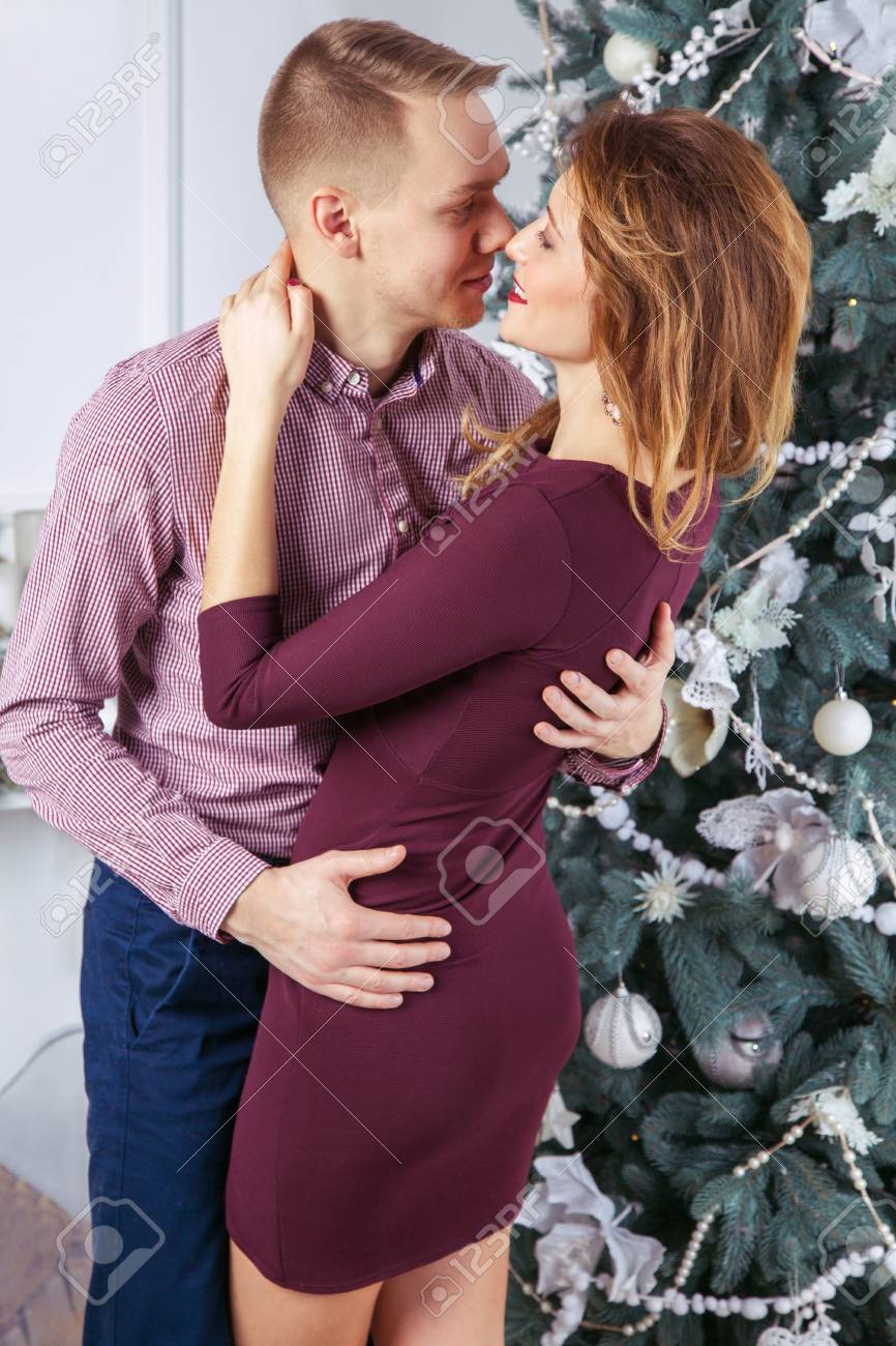 Young Beautiful Love Couple Celebrating New Year Woman And Man