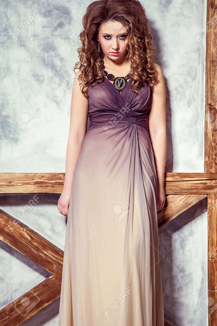 Fashion Model With Long Dress And Curly Hairstyle And Makeup Stock Photo Picture And Royalty Free Image Image 69820880