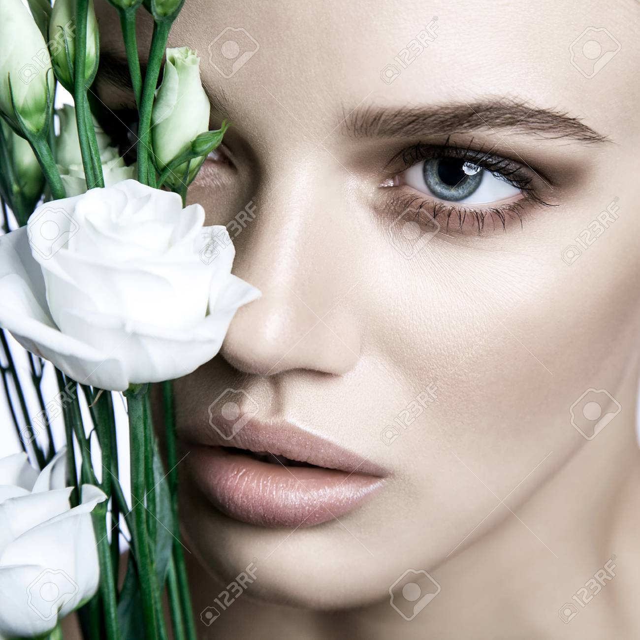 Calm Beauty Fashion Model Woman Face Portrait With White Rose