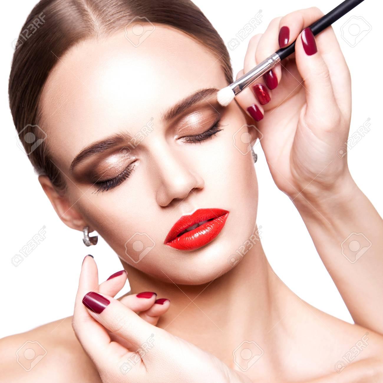 Professional Makeup Artist Applies Makeup For Beautiful Young
