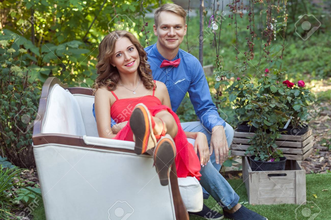 99156854-happy-couple-sitting-in-a-large