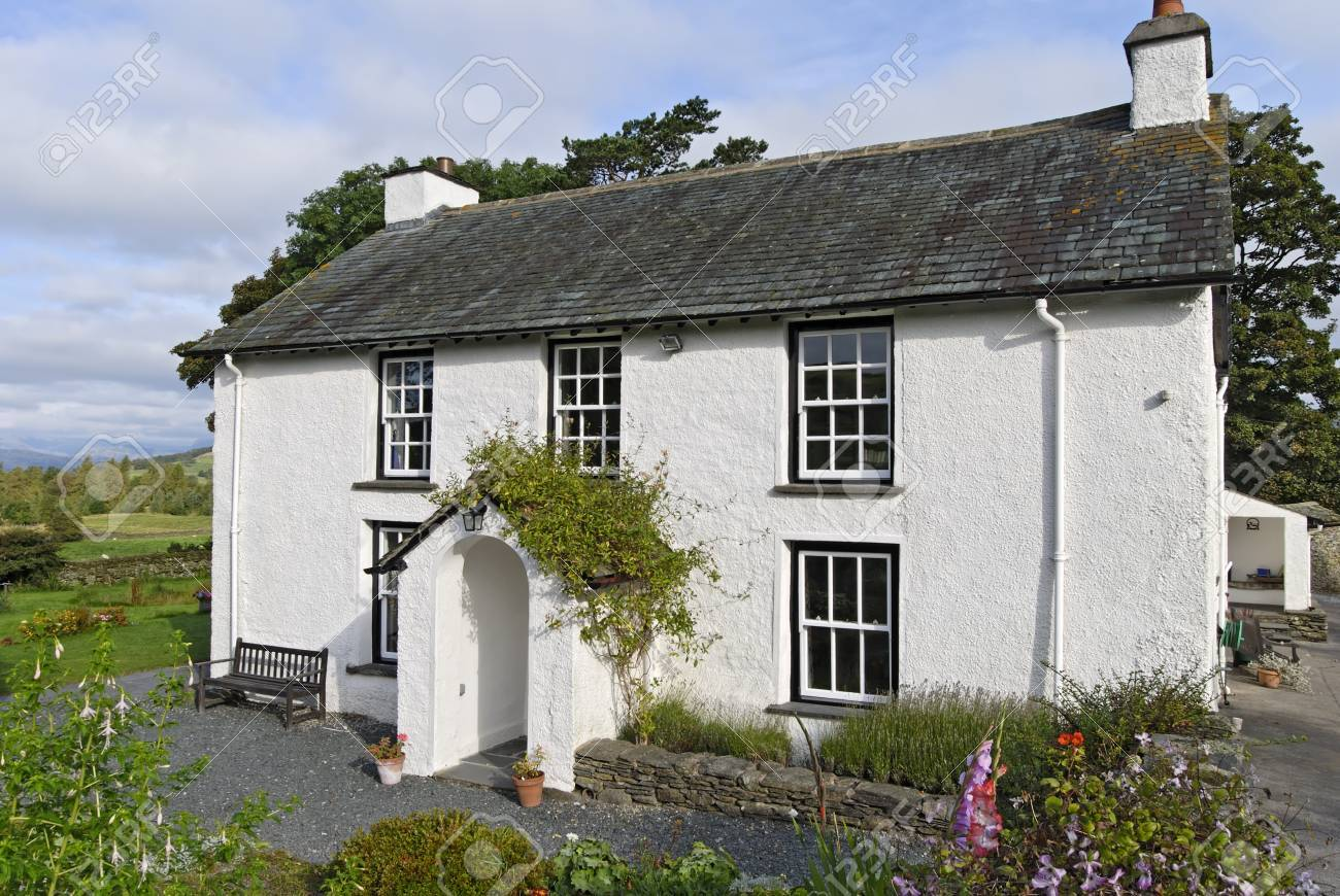A Typical whitewashed country cottage set in open countryside in the English Lake District Stock Photo - 1684165