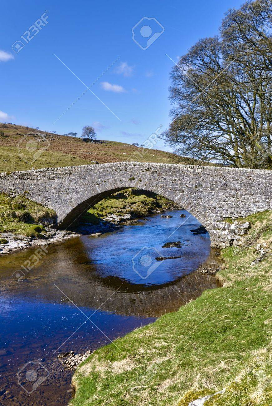 Scenic view of stone packhorse bridge over river Wharfe, Wharfedale Valley, Yorkshire, England. Stock Photo - 4888529