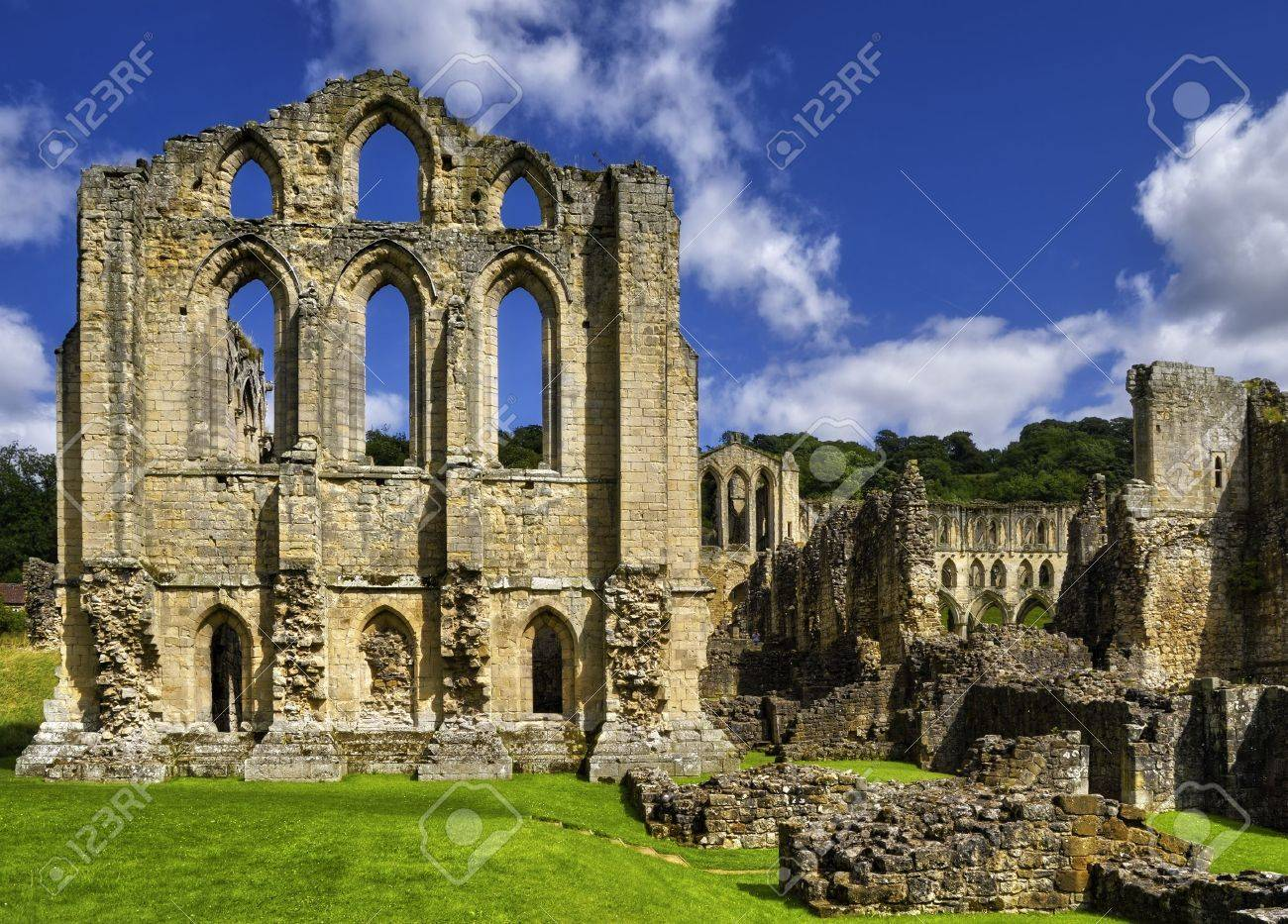 Scenic view of ruins of Rievaulx Abbey under cloudscape, North Yorkshire Moors, National Park, England. Stock Photo - 5529197