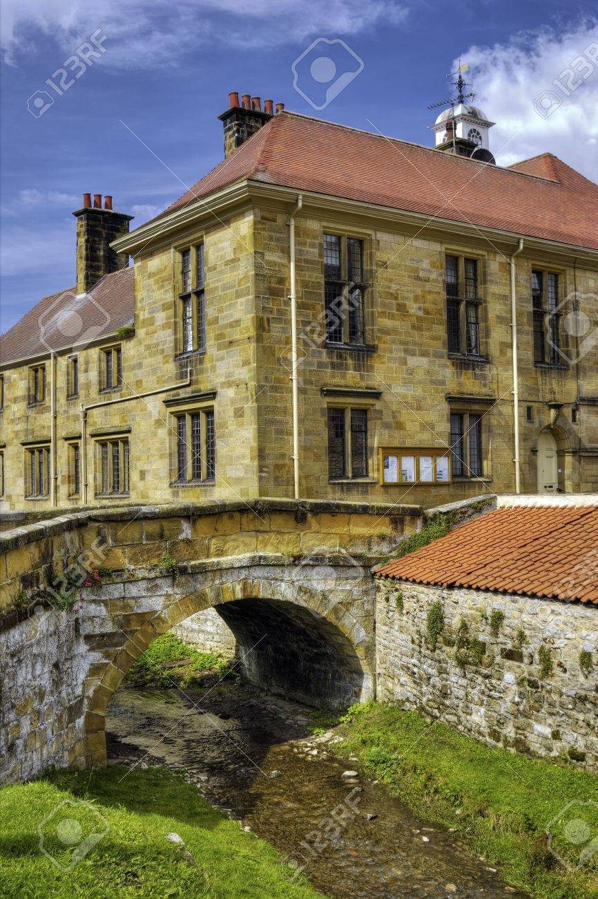 Scenic view of river flowing under bridge with Helmsley town in background, Ryedale, North Yorkshire, England. Stock Photo - 5546720