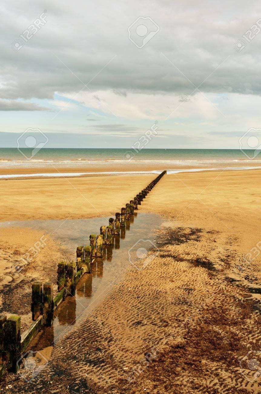A Sandy beach and a groyne in the seaside resort of Bridlington on the East coast of England Stock Photo - 14839519