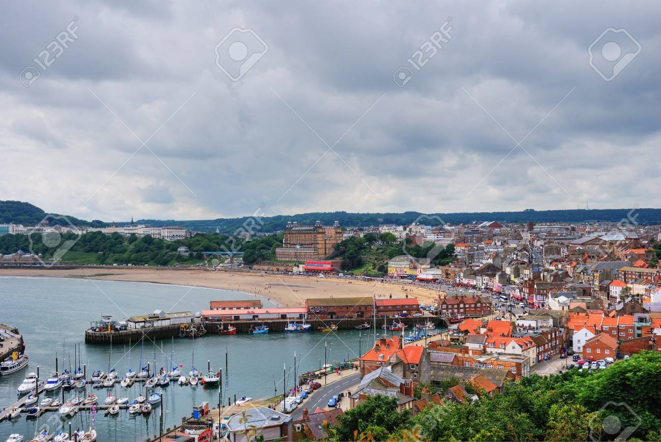 An aerial view over the English coastal resort of Scarborough, with it s harbour and sandy beach Stock Photo - 14964504