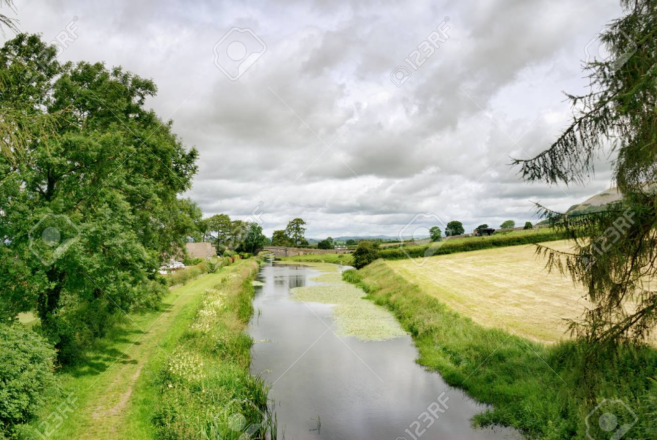 A peaceful tree lined stretch of the  Lancaster canal at Holme, Cumbria Stock Photo - 15326232