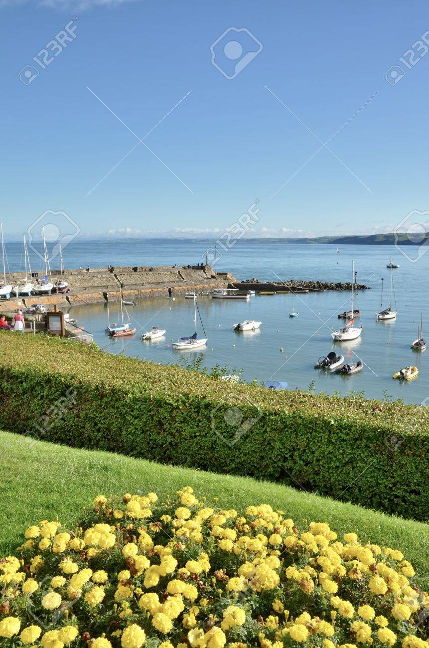 A view of boats moored in the quiet haven of New Quay harbour, Cardigan Bay, Ceredigion on a summers day Stock Photo - 16814181
