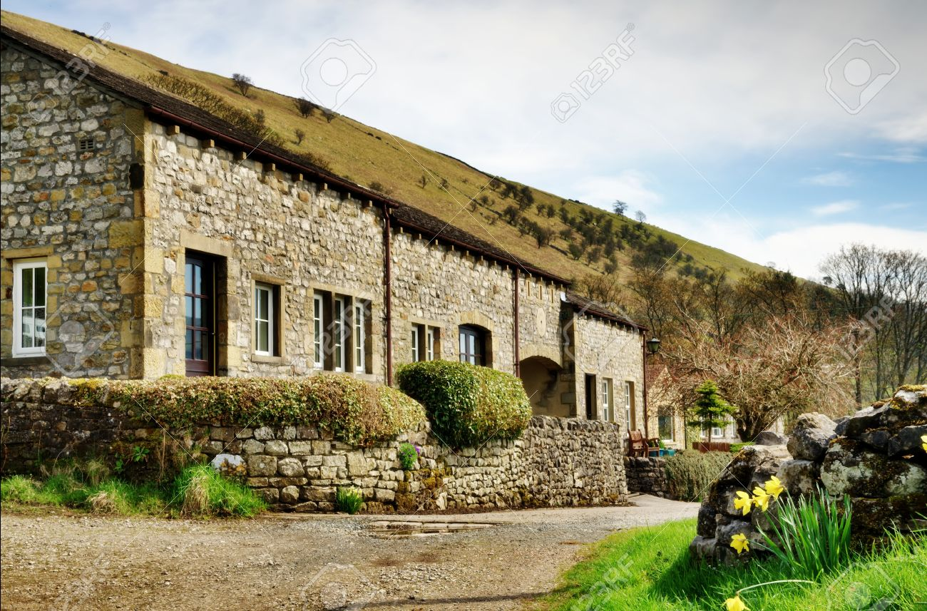 A  row of pretty stone built cottages in the village of Buckden, Wharfedale in the Yorkshire Dales, England, on a Spring Day Stock Photo - 20299006
