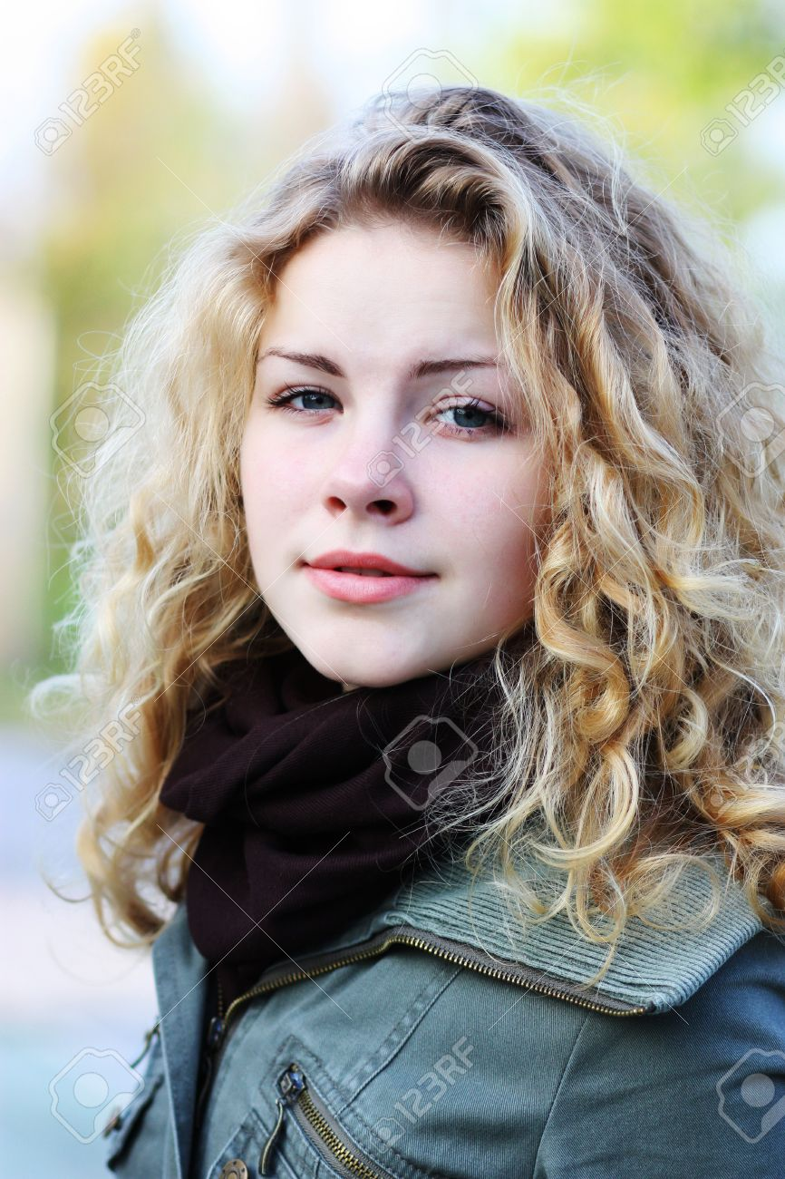 Incredible Blonde Girl With Curly Hair On Natural Background Stock Photo Hairstyle Inspiration Daily Dogsangcom