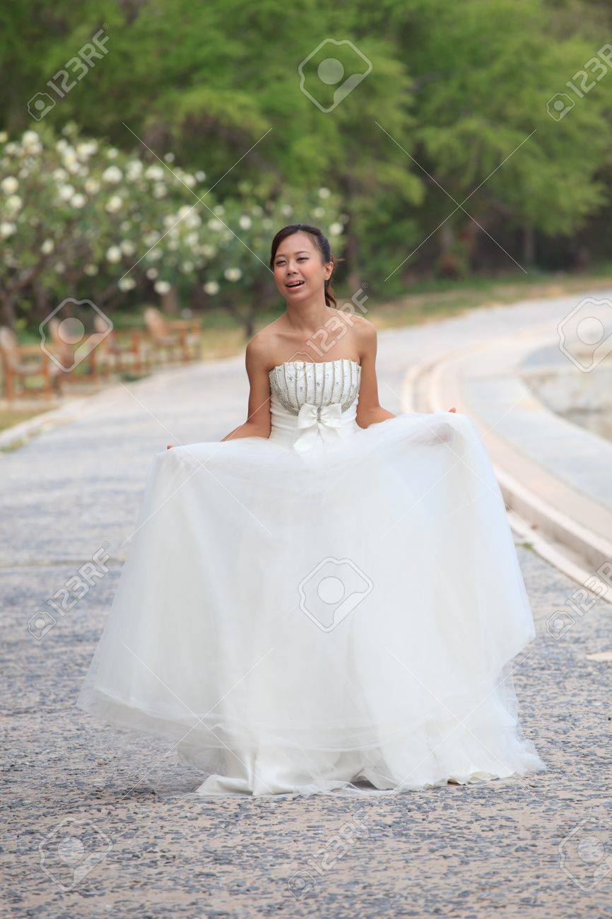 women in white bride post for take a photo in park Stock Photo - 12725200