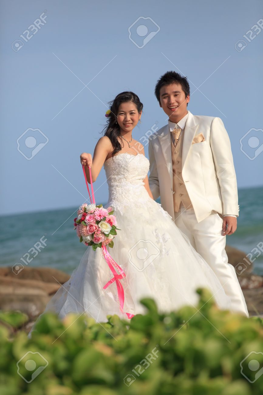 Man And Woman In Wedding Suit At Sea Beach Stock Photo, Picture And ...