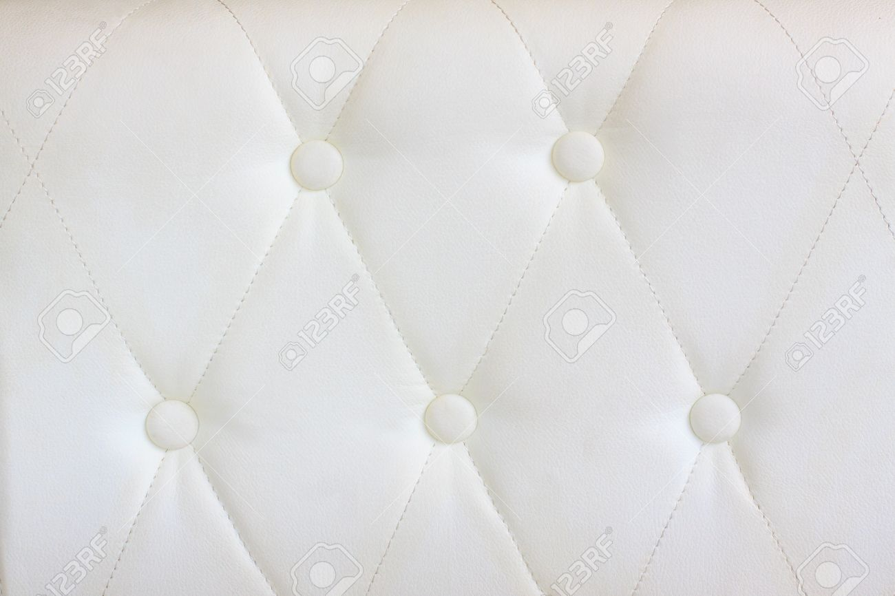 luxury white  leather with a botton use as background texture Stock Photo - 14321891
