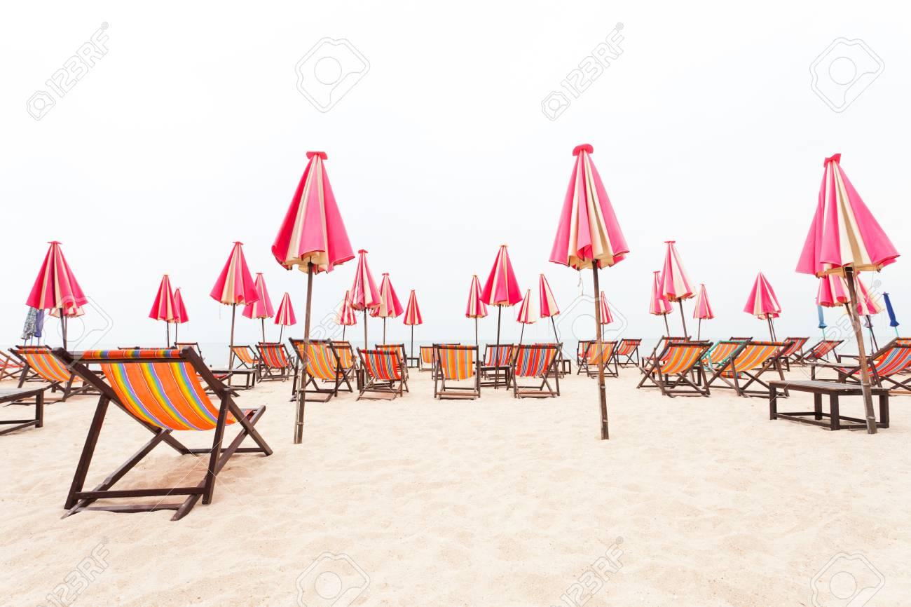 chairs beach and umbrella on sand beach Stock Photo - 14549988