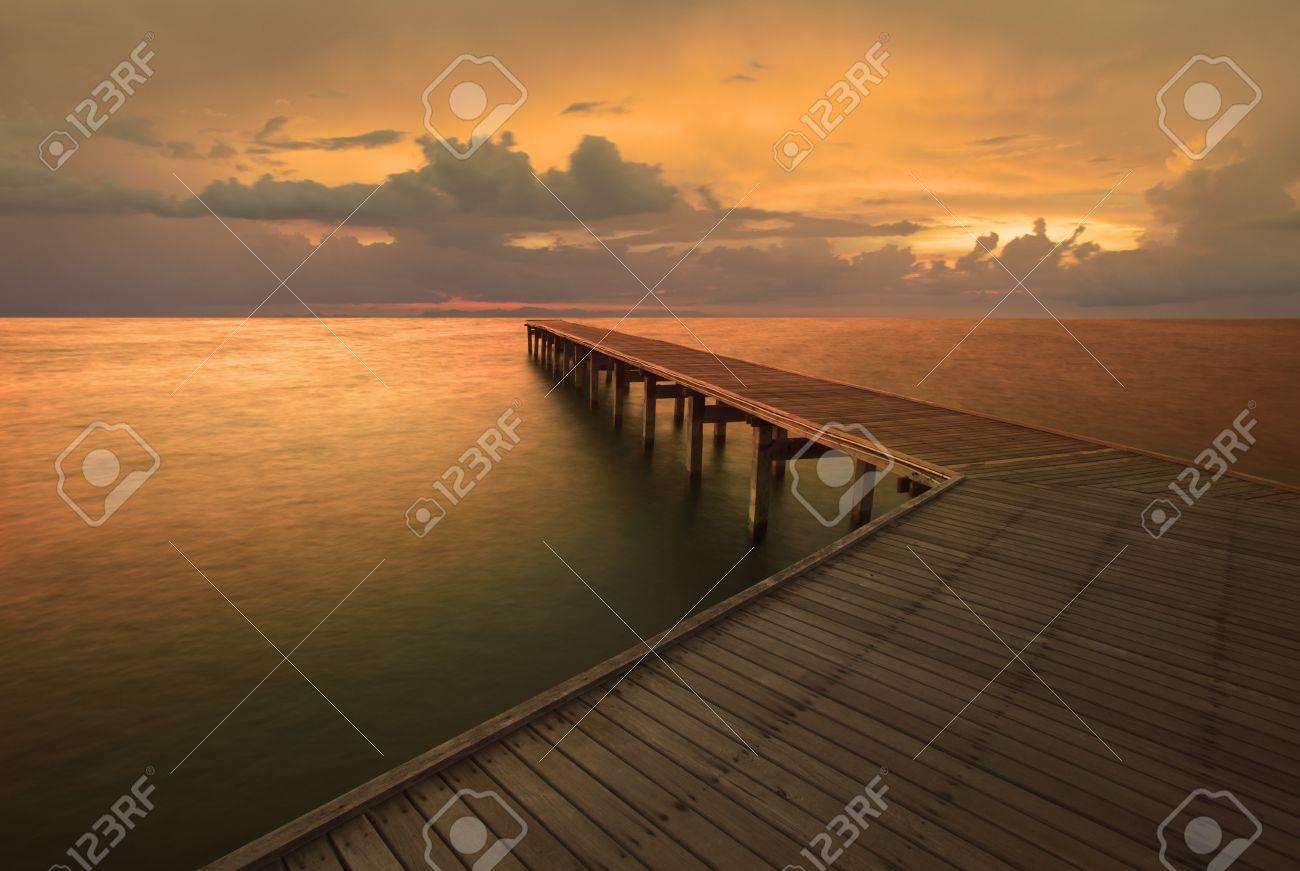 dusky sky and old wood bridge pier Stock Photo - 17362741