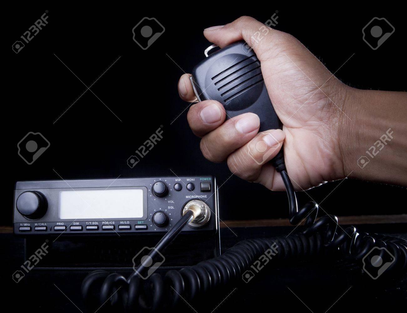 hand of Amateur radio holding speaker and press for radio communication theme - 20411426