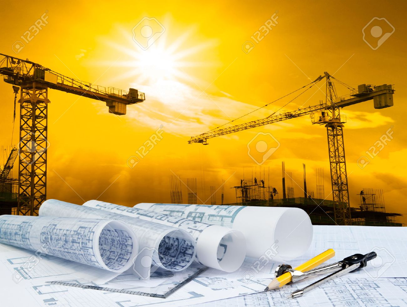 architect plan on working table with crane and building construction - 23858634