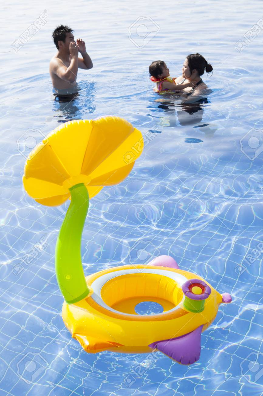 family in water pool with children toy playing with happiness Stock Photo - 25207688
