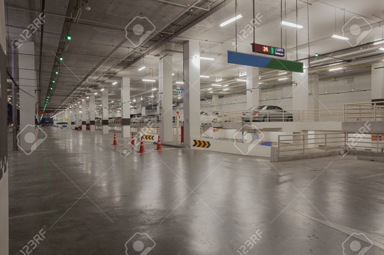 car parking lot available in side carpark building with red and green led  light sign Stock. Car Parking Lot Available In Side Carpark Building With Red And