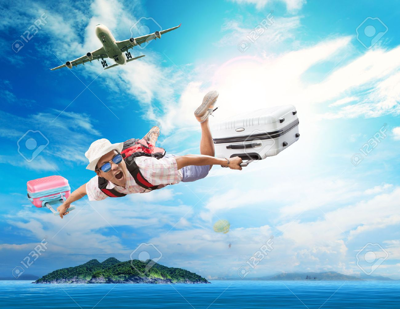 young man flying from passenger plane to natural destination island on blue ocean with happiness face emotion use for people traveling on vacation holiday in summer season - 39903089